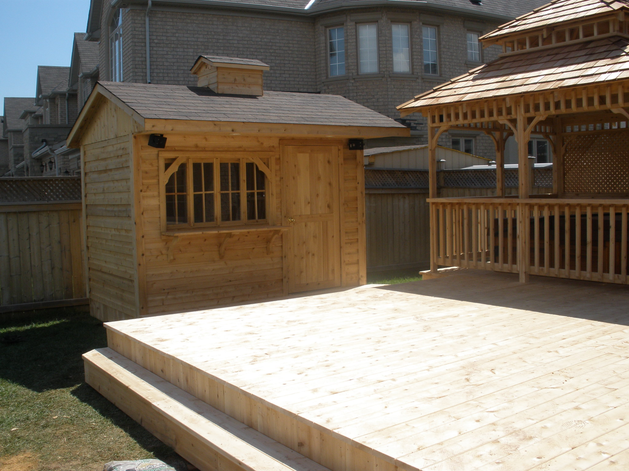 Cedar deck, bar and hot tub enclosure