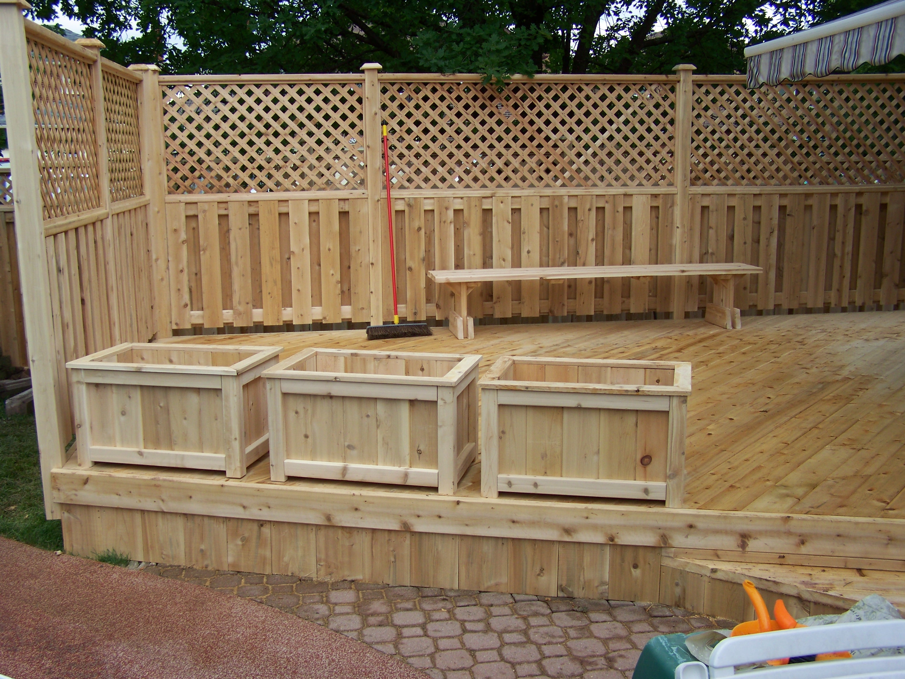 Custom cedar deck, handrail and planters